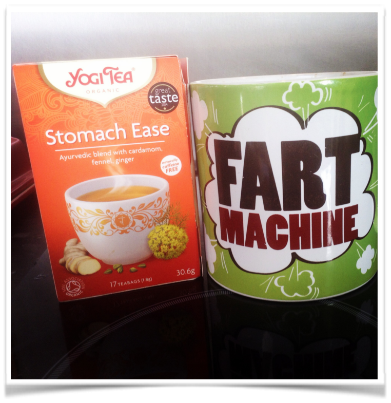 Gut health Yogi Tea packet next to a green fart machine mug